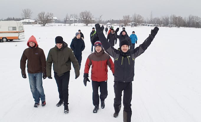 Group of happy Classcraft employees walking outside in the winter time and a team-building event
