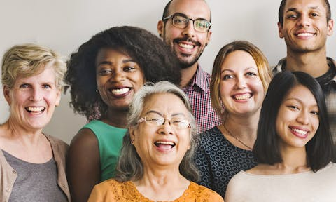 8 people posing for a group photo smiling and laughing