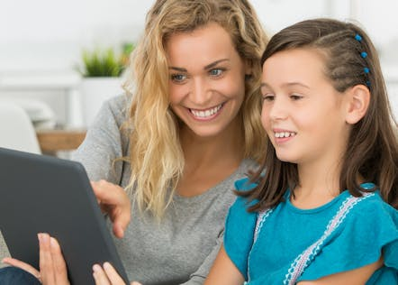 Mother helping her child with distance learning and Classcraft